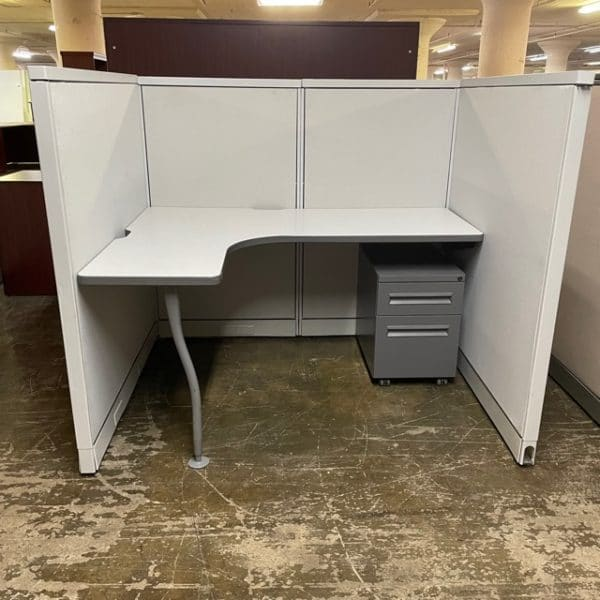 """Steelcase Avenir Workstation in light gray. The cubicle is 5' x 4' x 52"""" high. They each come with one dark gray mobile pedestal."""